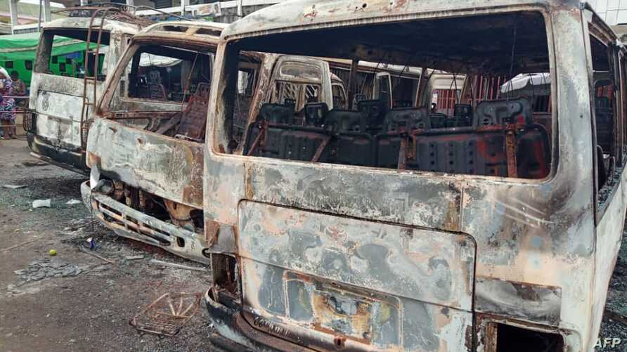 FILE - Burned buses are seen at the bus terminal in Buea, Cameroon, July 10, 2018. Gunfire broke out on July 9 in Buea, the capital of a western region of Cameroon gripped by violence between anglophone separatists and security forces.