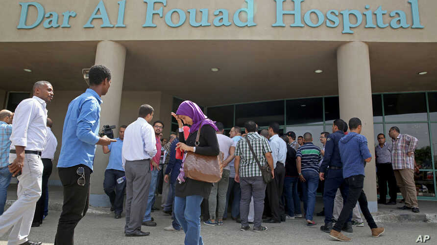 Egyptian journalists wait for information about tourists who were injured Sunday while on a desert safari trip, in front of the Dar Al Fouad Hospital in Cairo, Egypt, Sept. 14, 2015.
