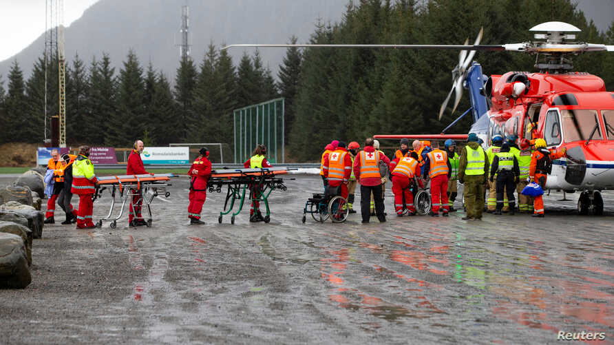 Passengers are helped out of a rescue helicopter after being rescued from cruise ship 'Viking Sky' in Hustadvika,Norway, March 24, 2019. (Svein Ove Ekornesvag/NTB Scanpix/via Reuters)