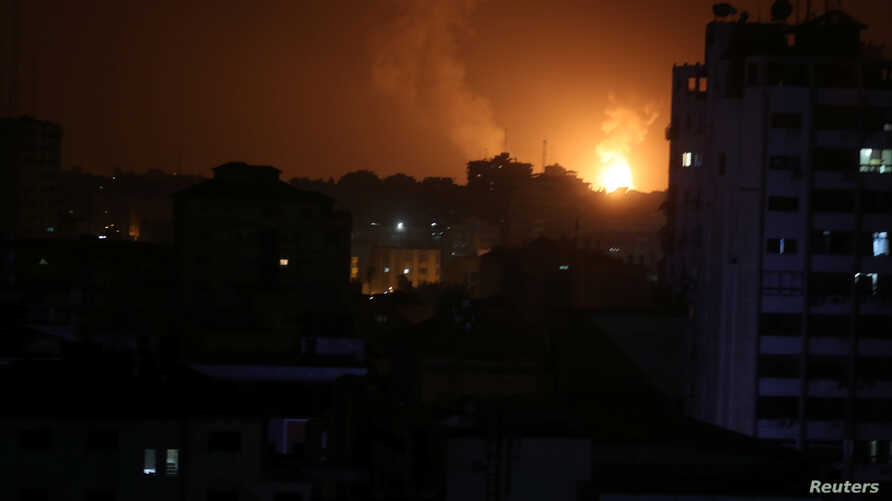 Smoke and flame are seen during an Israeli airstrike in Gaza, March 15, 2019.