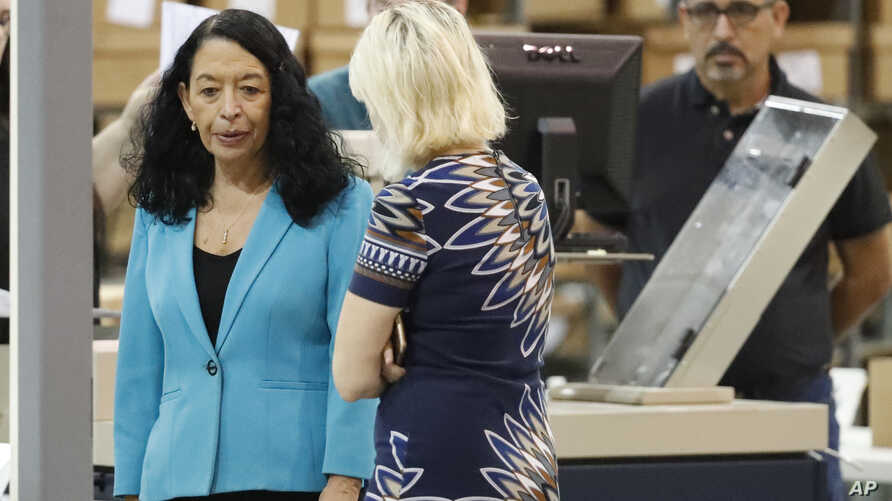 Palm Beach County Supervisor Of Elections Susan Bucher, left, speaks to employees before starting a recount at the Supervisor of Elections office, Nov. 15, 2018, in West Palm Beach, Florida.