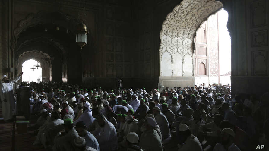 Pakistani Muslims offer Friday prayers at Badshahi Mosque during the holy fasting month of Ramadan, in Lahore, Pakistan, Friday, June 2, 2017.