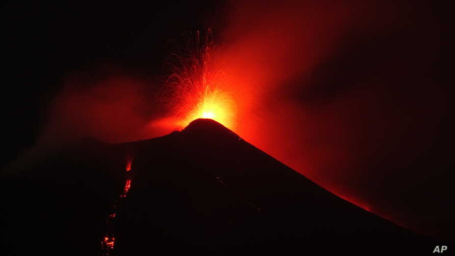 In this photo taken late on Aug. 23, 2018, Mount Etna volcano spews lava during an eruption.
