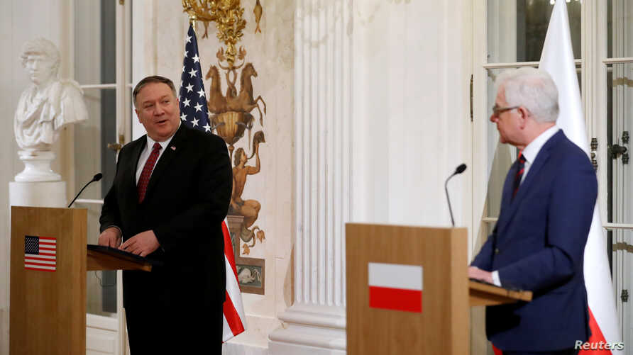 Polish Foreign Minister Jacek Czaputowicz and U.S. Secretary of State Mike Pompeo hold a news conference at Lazienki Palace in Warsaw, Feb. 12, 2019.