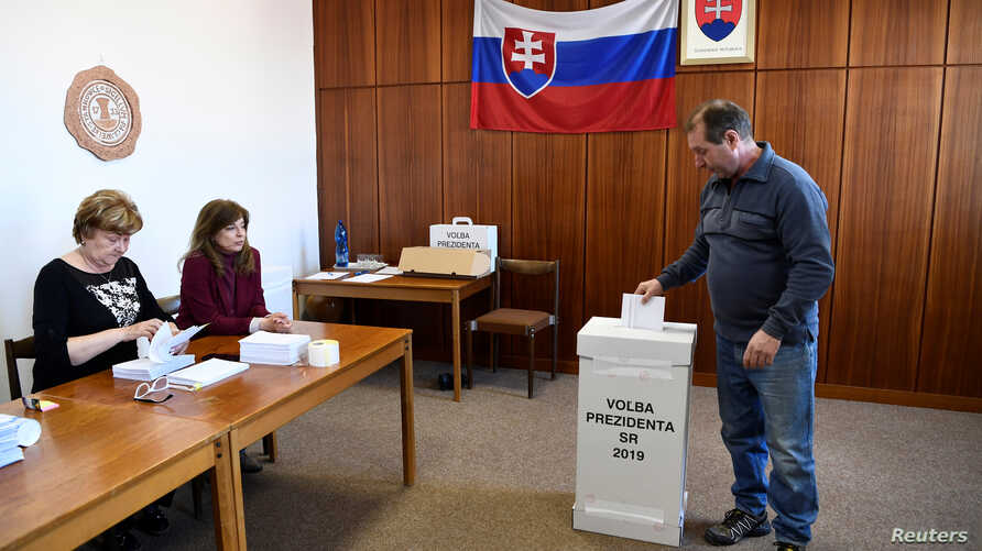 A man casts his vote in Slovakia's presidential election run-off, at a polling station in Trencianske Stankovce, Slovakia, March 30, 2019.