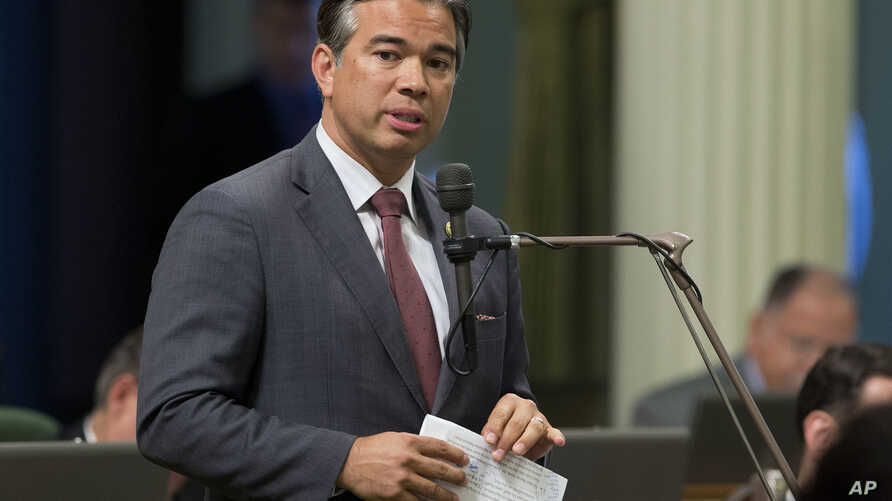 FILE -- California Assemblyman Rob Bonta, D-Alameda, speaks during a legislative session, in Sacramento, Calif., Aug. 31, 2016. A bill sponsored by Bonta that would have prevented California state employees from being fired for being a member of the