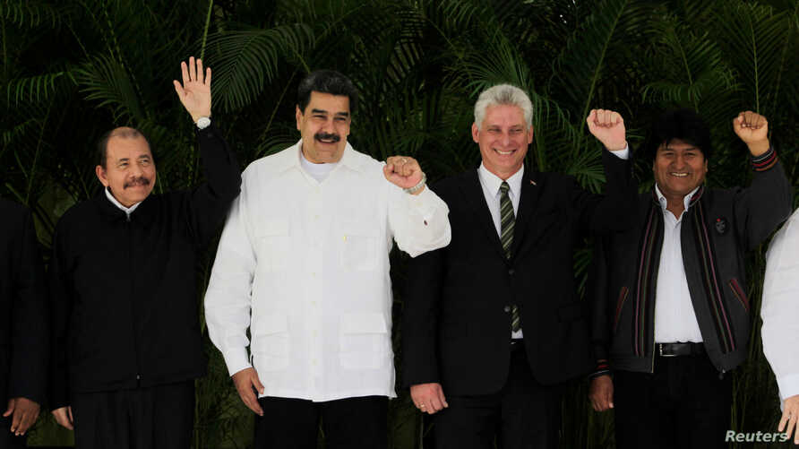 Nicaragua's President Daniel Ortega, Venezuela's President Nicolas Maduro, Cuba's President Miguel Diaz-Canel and Bolivia's President Evo Morales pose during the 16th Bolivarian Alliance for the Peoples of Our America - Peoples's Trade Agreement (ALB