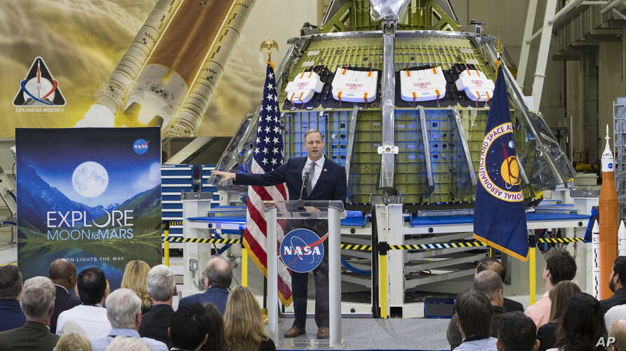 NASA Administrator Jim Bridenstine talks to employees about the agency's progress toward sending astronauts to the moon and on to Mars during a televised event, Monday, March 11, 2019, at the Neil Armstrong Operations and Checkout Building at NASA's