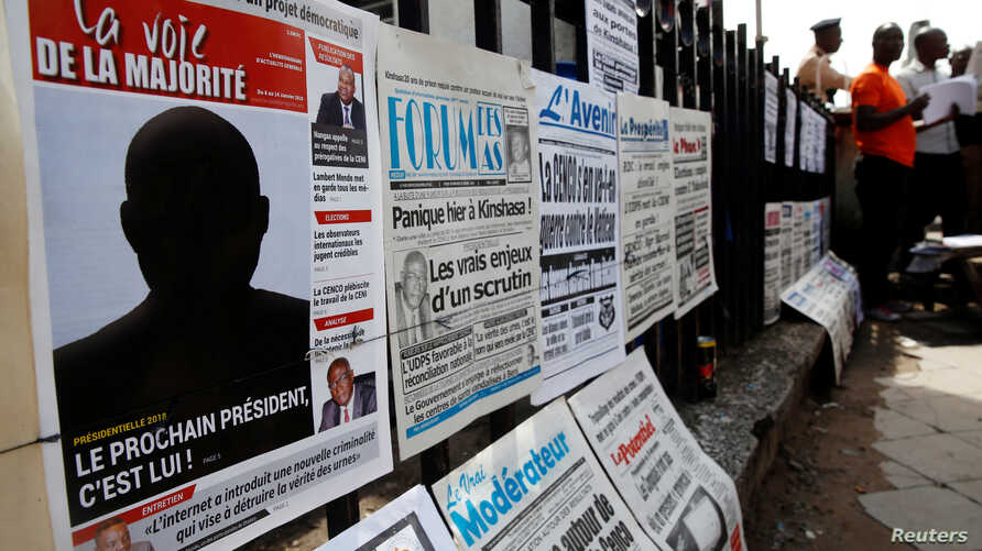 "A Congolese news paper with the headline ""The next president is him"" is seen at a news stand in Kinshasa, Democratic Republic of Congo, Jan. 9, 2019."