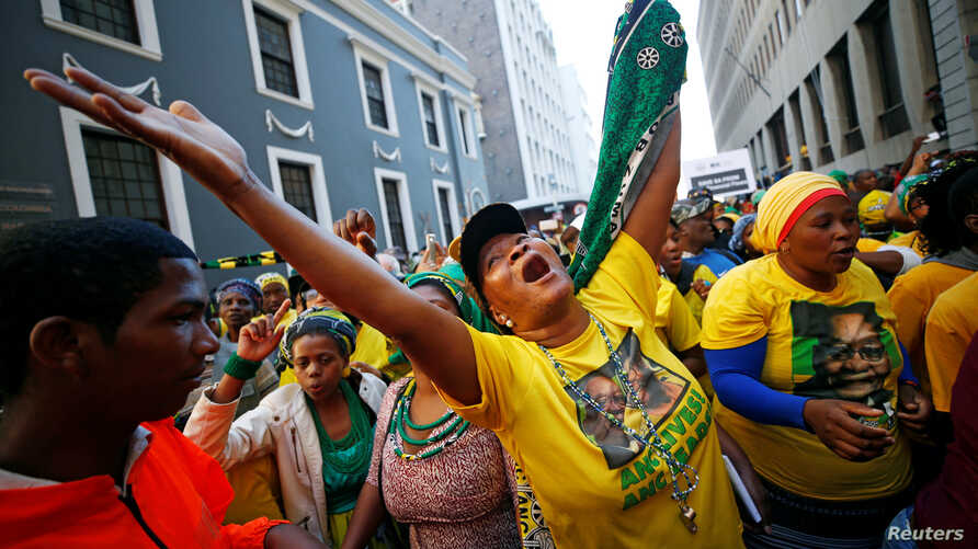 Pro-Zuma supporters cheer during the vote of no confidence against President Jacob Zuma in Cape Town, South Africa, Aug. 8, 2017.