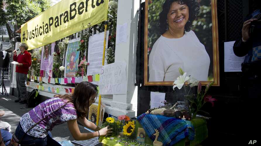 Mexico Honduras Environmentalist Killed: A woman places flowers on an altar set up in honor of Berta Caceres during a demonstration outside Honduras' embassy in Mexico City, Wednesday, June 15, 2016.