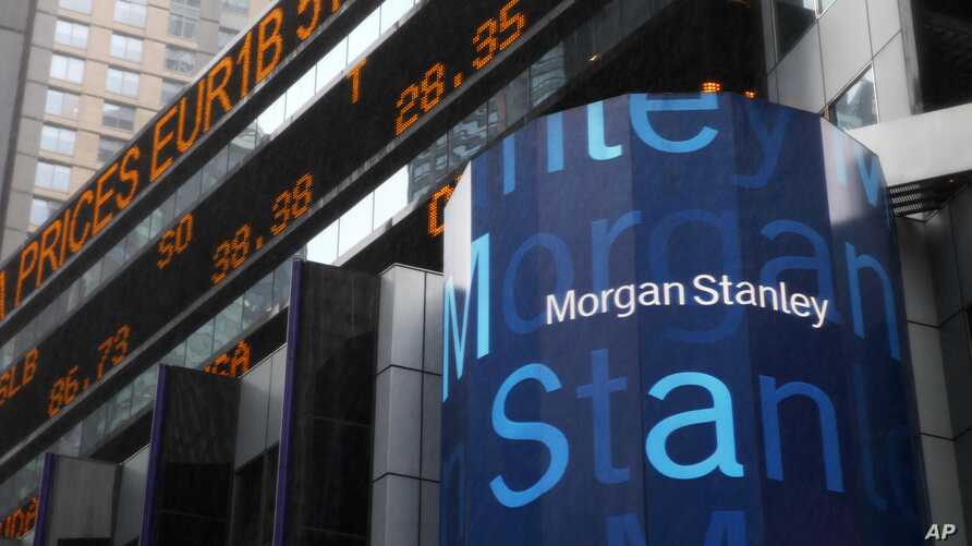 FILE - A Morgan Stanley billboard is displayed in Times Square, New York, Jan. 18, 2011. Morgan Stanley plans to offer savings accounts and certificates of deposits next year to wring more profit from its wealth management clients, executives told Re