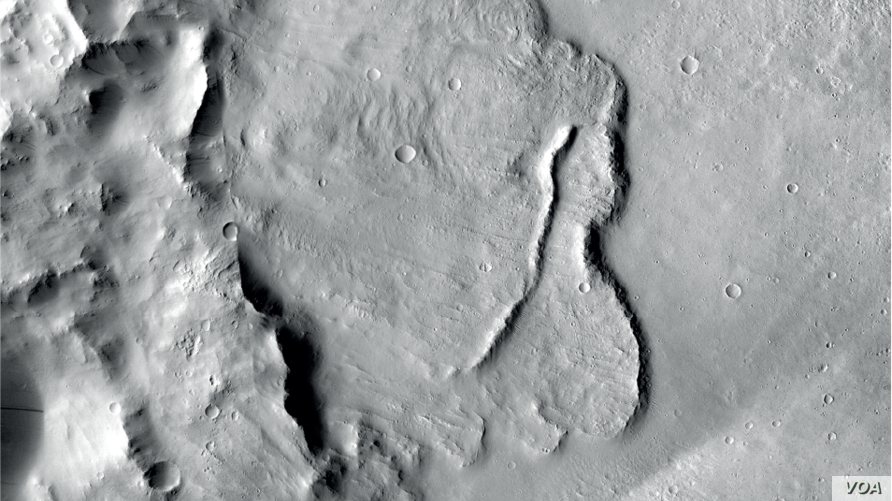Example of features identified in a deep basin on Mars that show it was influenced by groundwater billions of years ago. (NASA/JPL-Caltech/MSSS)