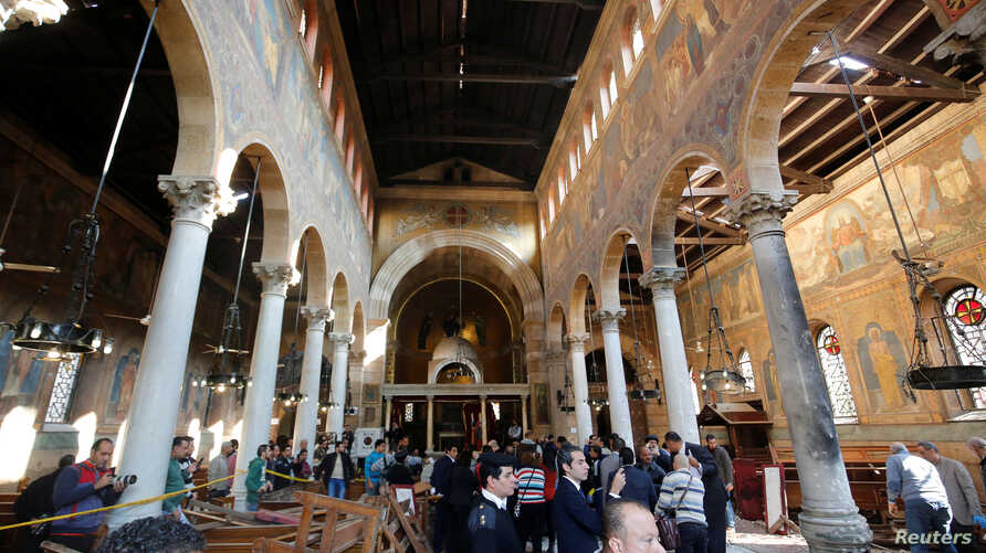 Egyptian security officials and investigators inspect the scene following a bombing inside Cairo's Coptic cathedral in Egypt, Dec. 11, 2016.
