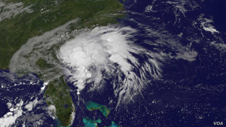 NOAA's GOES-East satellite captured this visible image of Tropical Storm Julia on Sept. 14 at 8:37 a.m. EDT (1237 UTC), centered just 10 miles west of Brunswick, Georgia.