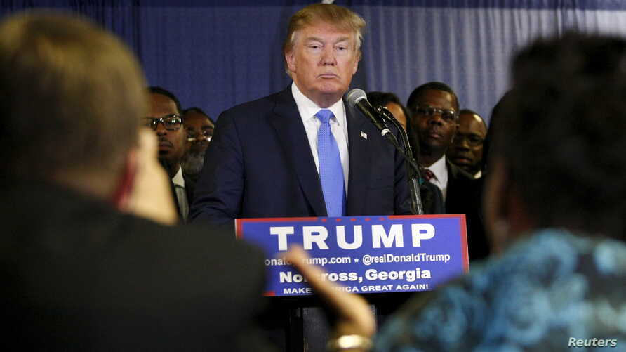 FILE - U.S. Republican presidential candidate Donald Trump, surrounded by members of Atlanta's black clergy, speaks at a news conference in Norcross, Georgia, Oct. 10, 2015.