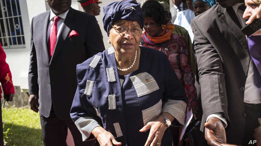 FILE - Sierra Leone President, Ernest Bai Koroma, left, and Liberia President, Ellen Johnson Sirleaf, right, on arrival for talks with President Yahya Jammeh, in Banjul, Gambia.