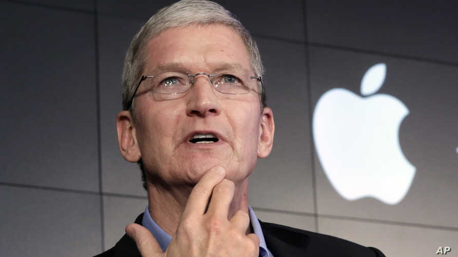 FILE – Apple CEO Tim Cook contends that complying with a g