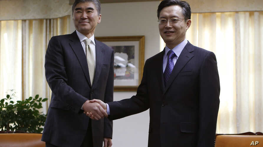 FILE - Hwang Joon-kook, right, South Korea's special representative for Korean Peninsula affairs — shown in Seoul in December with U.S. Special Representative for North Korea Policy Sung Kim — says the exploratory talks would test Pyongyang's will to