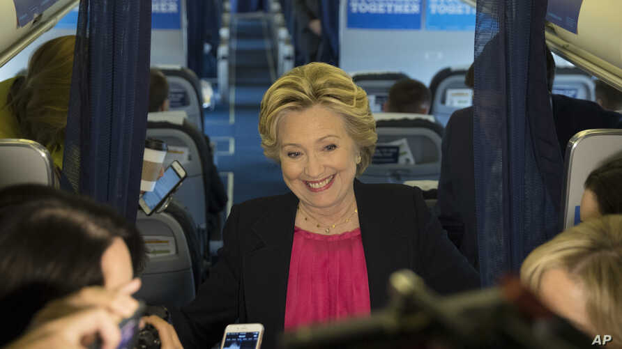 Democratic presidential candidate Hillary Clinton speaks with members of the media on board her campaign plane at Westchester County Airport in White Plains, N.Y., Sept. 27, 2016.