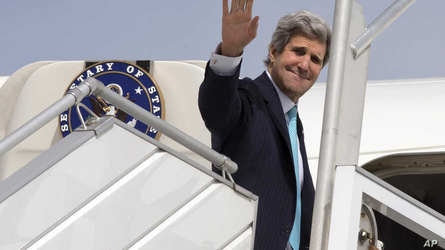 U.S. Secretary of State John Kerry leaves Paris, March 31, 2014, for a trip to the Middle East to work on talks about the Middle East peace process.