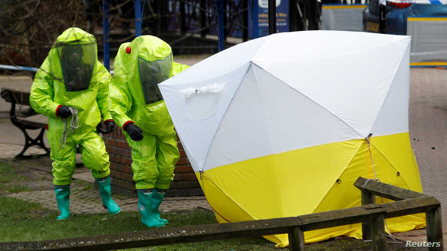 The forensic tent, covering the bench where Sergei Skripal and his daughter Yulia were found, is repositioned by officials in protective suits in the center of Salisbury, Britain, March 8, 2018.