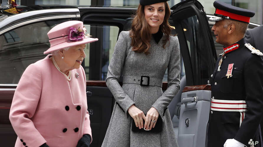 Britain's' Queen Elizabeth II accompanied by Kate, Duchess of Cambridge arrives at Kings College in London, March 19, 2019.