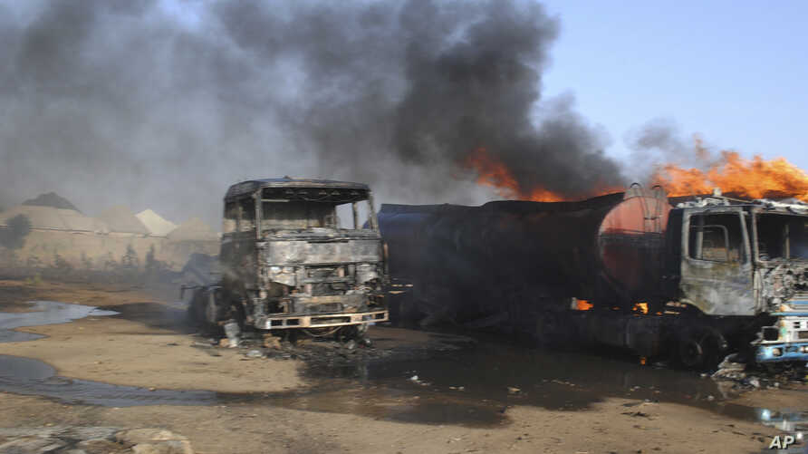 Burnout petrol tankers following a suicide attack in Maiduguri, Nigeria, March. 3, 2017. Three suicide bombers set ablaze three fuel tankers in the center of Nigeria's northeastern city of Maiduguri before dawn, officials said,