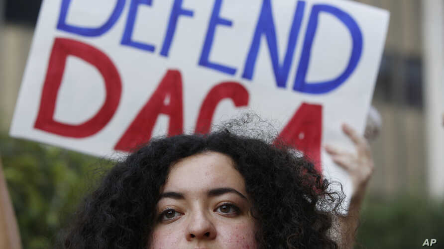 Loyola Marymount University student and dreamer Maria Carolina Gomez joins a rally in support of the Deferred Action for Childhood Arrivals, or DACA program, outside the Edward Roybal Federal Building in Los Angeles, Sept. 1, 2017.