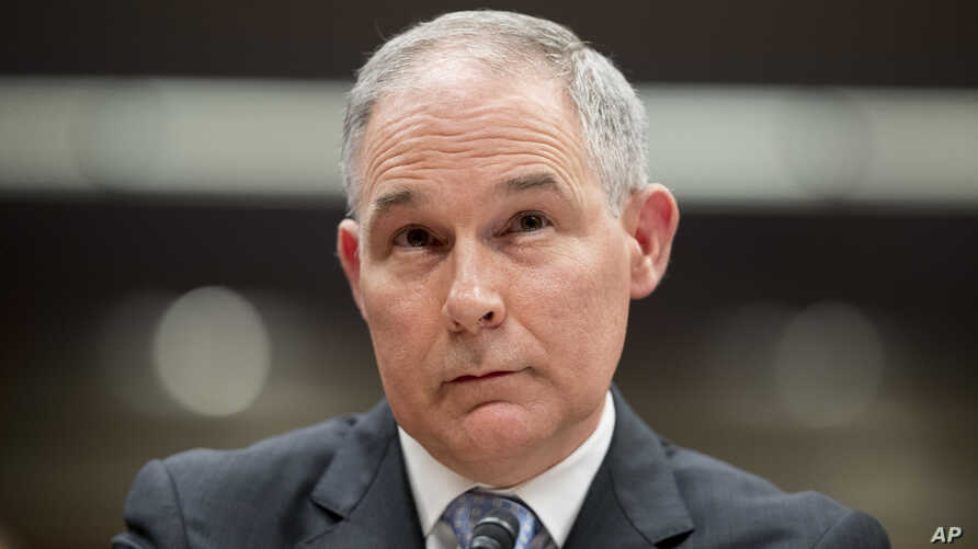 FILE - Environmental Protection Agency Administrator Scott Pruitt appears before a Senate Appropriations subcommittee on the Interior, Environment, and Related Agencies on budget on Capitol Hill in Washington, May 16, 2018. Newly filed disclosure rep