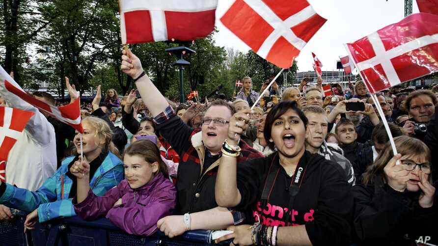 FILE - People in Tivoli in Copenhagen Denmark, May. 19, 2013. The United Nations made it official on March 16, 2016: It found Danes to be the happiest people on Earth, in a study of 156 countries.