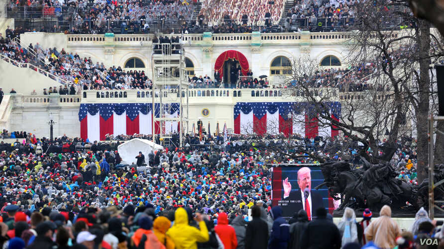 President Donald Trump speaks to the crowd in front of the Capitol during his inaugural address. January 20, 2017 (B. Allen / VOA)