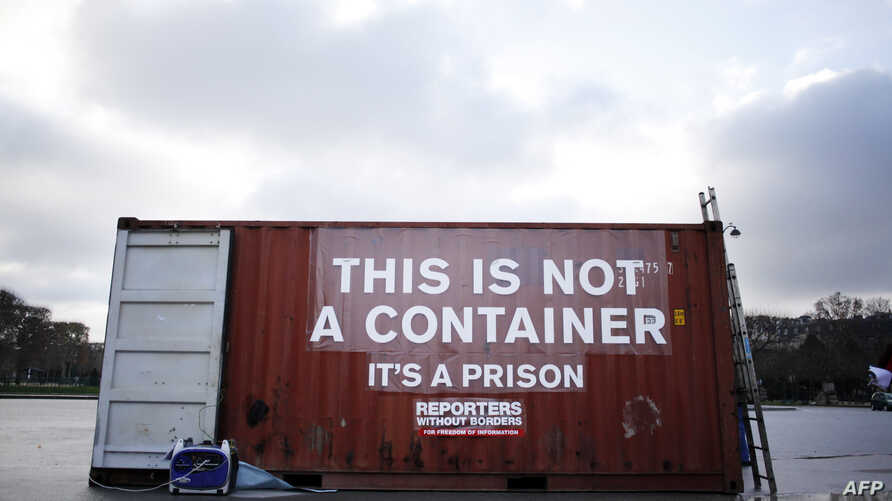 FILE - A shipping container stands in position during a demonstration by the press freedoms organization Reports Sans Frontier (Reporters Without Borders) in Paris, Dec. 16, 2014. Reports from inside Eritrea describe inhumane conditions where prisone