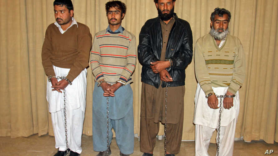 Pakistanis accused of being the facilitators of the deadly attack on a university are presented to the media, in Peshawar, Pakistan, Jan. 23, 2016.