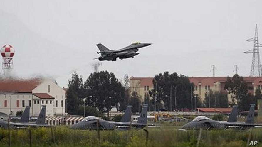 A Danish F-16 aircraft takes off from the NATO airbase in Sigonella, on the southern Italian Sicily island, March 20, 2011