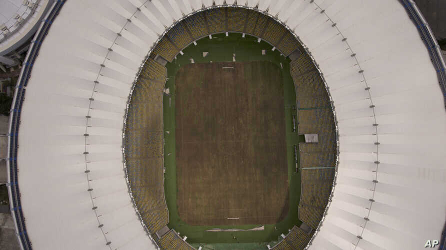 This Feb. 2, 2017 photo shows Maracana stadium's dry playing field in Rio de Janeiro, Brazil. The stadium was renovated for the 2014 World Cup at a cost of about $500 million, and largely abandoned after the Olympics and Paralympics, then hit by vand