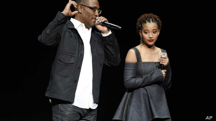 "George Tillman Jr., left, director of the upcoming film ""The Hate U Give,"" and cast member Amandla Steinberg discuss the film during the 20th Century Fox presentation at CinemaCon 2018, the official convention of the National Association of Theatre O"