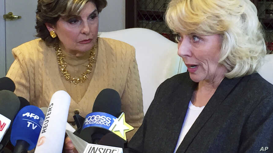 Heather Kerr, right, a former actress who alleges that entertainment mogul Harvey Weinstein sexually abused her in 1989, speaks with her attorney Gloria Allred at a news conference in Los Angeles, Oct. 20, 2017.