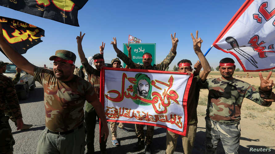 Shi'ite Popular Mobilization Forces (PMF) celebrate on the outskirts of Kirkuk, Iraq, Oct. 17, 2017.