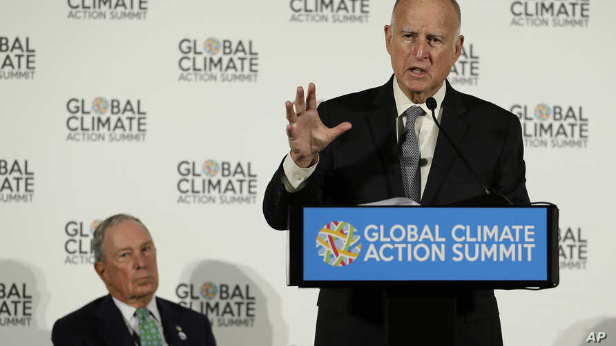 California Gov. Jerry Brown speaks as Michael Bloomberg (L) listens during a news conference at the Global Action Climate Summit, Sept. 13, 2018, in San Francisco.