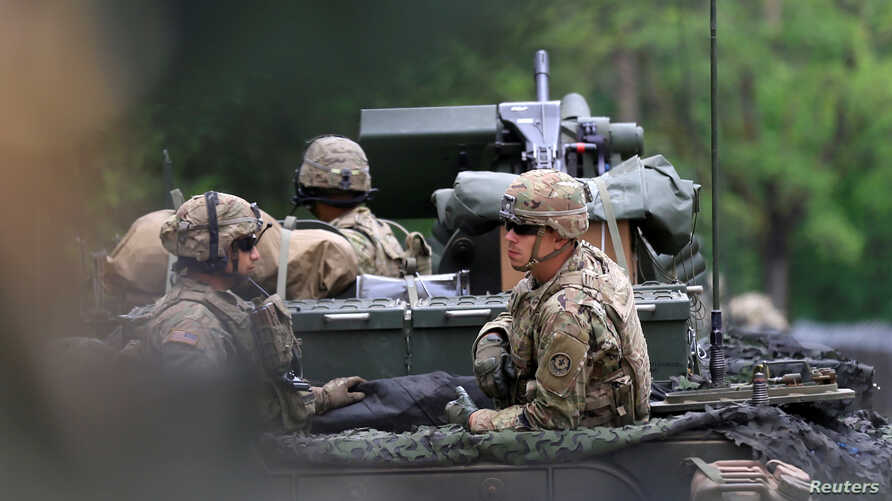 FILE - US soldiers sit in their Stryker armoured fighting vehicle during their ride to Suwalki direction near Orzysz, Poland.