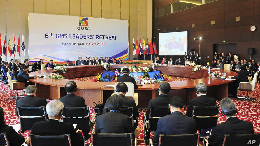 Leaders of six countries along the Mekong river - China, Myanmar, Thailand, Laos, Cambodia and Vietnam - attend a retreat during the Greater Mekong Summit in Hanoi, Vietnam, March 31, 2018.