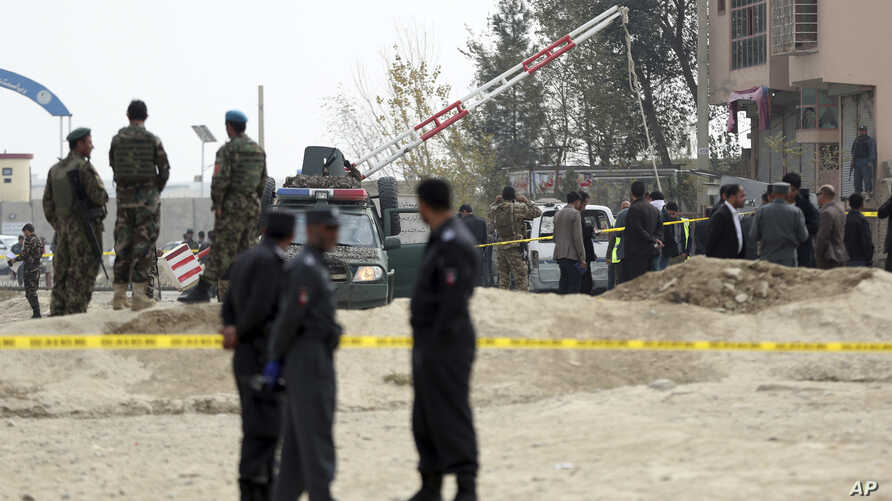 Security forces inspect the site of a suicide attack on prison employees' vehicle in Kabul, Afghanistan, Oct. 31, 2018.