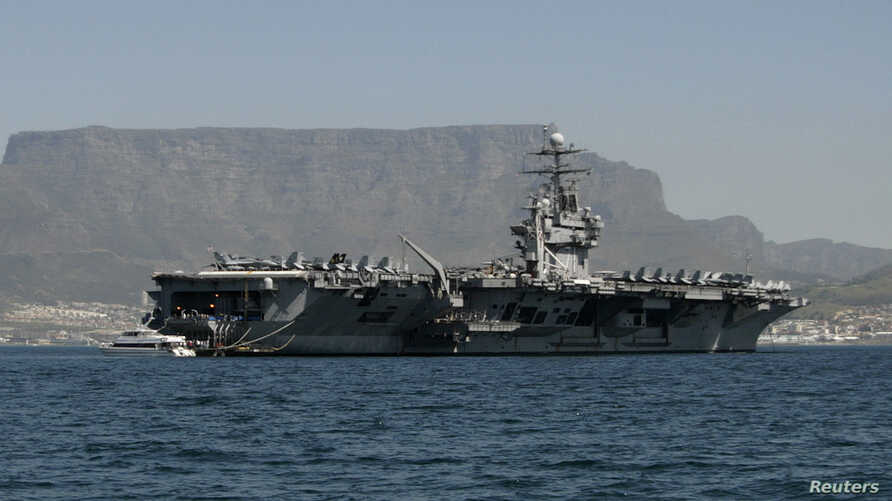 FILE - Aircraft carrier USS Theodore Roosevelt