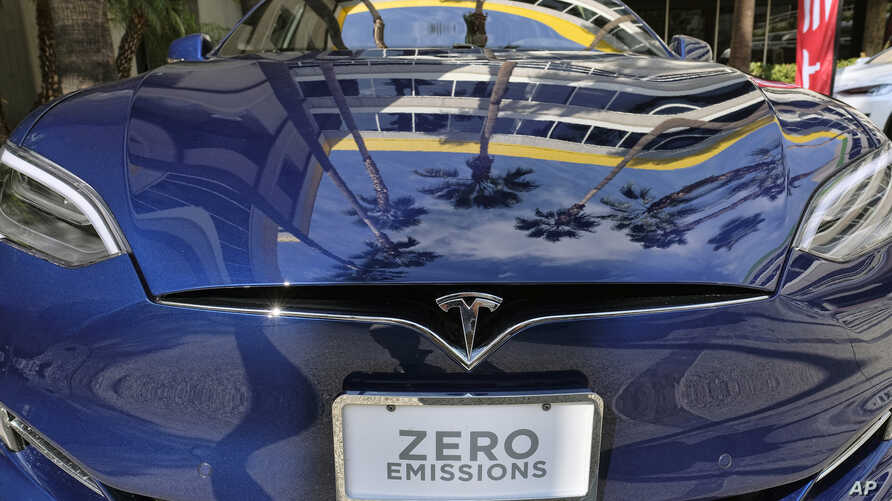 FILE - A Tesla Model S on display in downtown Los Angeles, Oct. 24, 2016. Tesla Motors fired hundreds of workers after completing its annual performance reviews, even though the electric automaker is trying to ramp up production to meet the demand fo