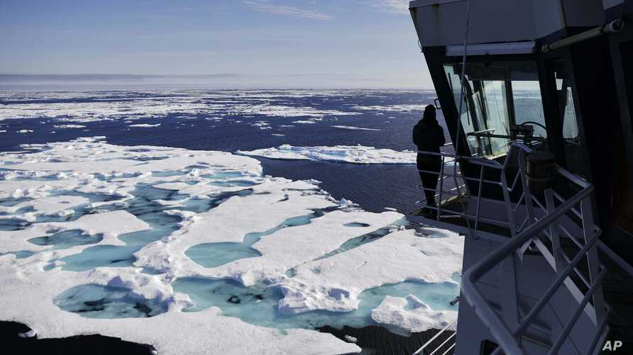 The Finnish icebreaker MSV Nordica sails through ice floating on the Chukchi Sea off the coast of Alaska, July 16, 2017, while traversing the Arctic's Northwest Passage.