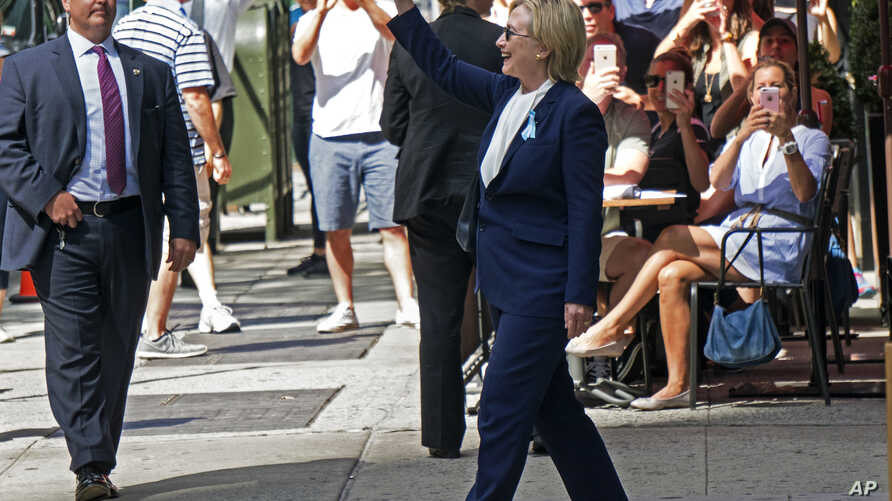 Democratic presidential candidate Hillary Clinton walks from her daughter's apartment building, Sept. 11, 2016, in New York.