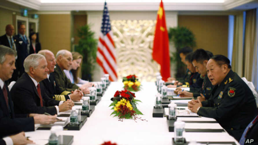U.S. Secretary of Defense Robert Gates (2nd L) meets China's Defense Minister Liang Guanglie (R) at the 10th International Institute of Strategic Studies Asia Security Summit: The Shangri-La Dialogue in Singapore June 3, 2011.
