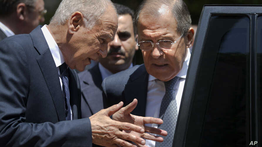 FILE - Russian Foreign Minister Sergey Lavrov, right, listens to Arab League Secretary-General, Ahmed Aboul Gheit, as he departs the Arab League headquarters after meetings, in Cairo, Egypt, Monday, May 29, 2017.
