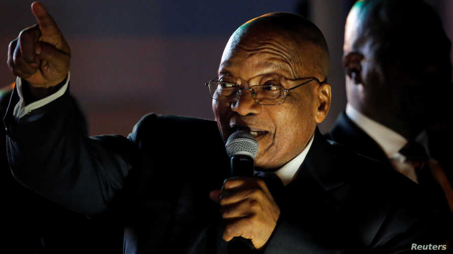 South Africa's President Jacob Zuma celebrates with his supporters after he survived a no-confidence motion in parliament in Cape Town, South Africa, August 8, 2017. Picture taken August 8, 2017.